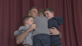 Navy dad surprises sons at Dublin elementary school