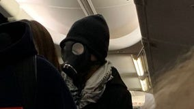 Man wearing gas mask on plane starts panic, has to be escorted off flight