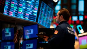 Dow sinks nearly 1,200 points in record drop as coronavirus worries spread