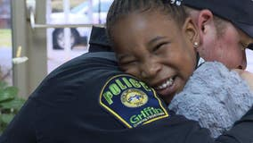 4-year-old hugs Griffin police officer after mom tells her officers are her 'friends'
