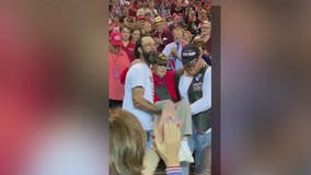WWII veteran carried to his seat by fellow Trump supporters at Phoenix campaign rally