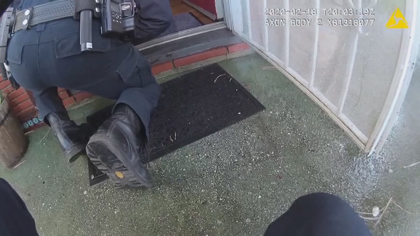 Body cam: California police officer saves man from burning home