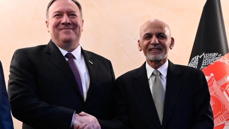 US Secretary of State Mike Pompeo (L) shakes hands with Afghan President Ashraf Ghani(R) during the 56th Munich Security Conference (MSC) in Munich, southern Germany, on February 14, 2020. (Photo by ANDREW CABALLERO-REYNOLDS/POOL/AFP via Getty Images)