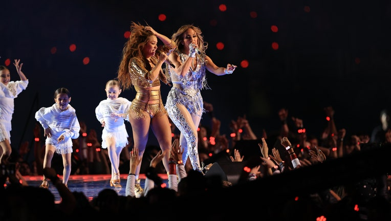 MIAMI, FLORIDA - FEBRUARY 02: Singers Shakira and Jennifer Lopez perform during the Pepsi Super Bowl LIV Halftime Show at Hard Rock Stadium on February 02, 2020 in Miami, Florida. (Photo by Andy Lyons/Getty Images)
