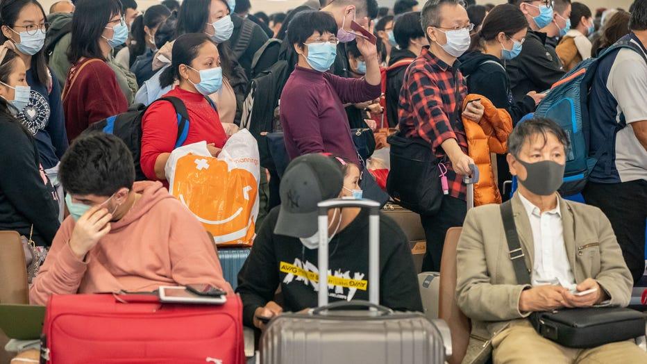 4a7a8c7b-Deadly Wuhan Coronavirus Spreads To Hong Kong