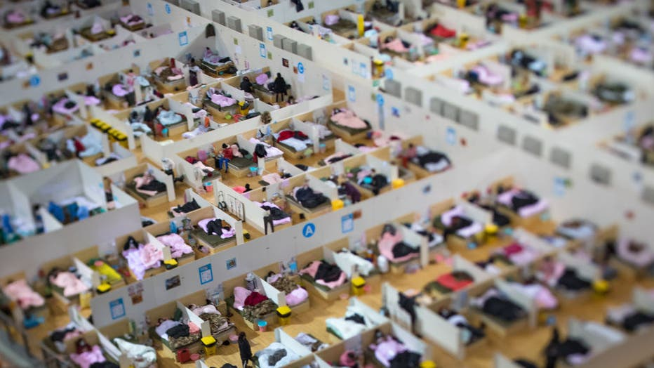 WUHAN, Feb. 17, 2020 -- Photo taken on Feb. 17, 2020 with a tilt-shift lens shows a temporary hospital converted from Wuhan Sports Center in Wuhan, central China's Hubei Province. The temporary hospital converted from Wuhan Sports Center designated to treat the COVID-19 patients in Wuhan has been in good order since the hospitalization of its first batch of patients on Feb. 12. (Photo by Xiao Yijiu/Xinhua via Getty) (Xinhua/Xiao Yijiu via Getty Images)