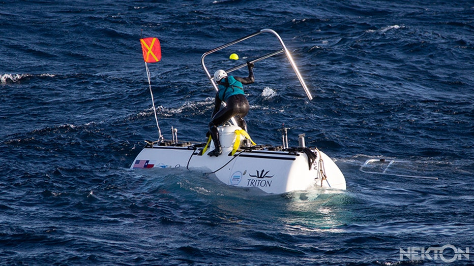 Nekton-Midnight-Zone-mission-safety-swimmer-taking-handrails-off-dsv-limiting-factor-before-descent.jpg