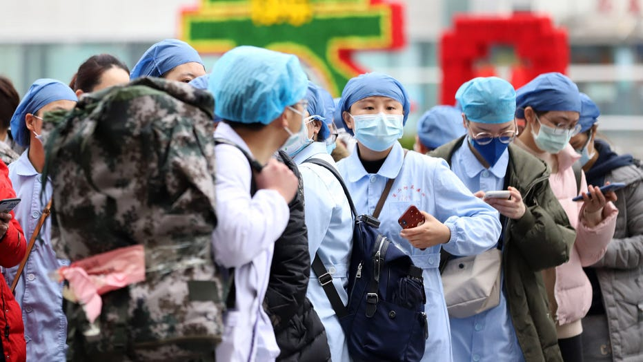 Medical personnel on a mission to help the COVID-19 patients in Hubei province wait to get onboard the express train leaving Nanchang city in central China's Jiangxi province on Feb. 13, 2020. (Photo credit: Feature China/Barcroft Media via Getty Images)