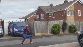 'Friendly neighborhood Spider-Man' entertains children while jogging amid COVID-19 pandemic