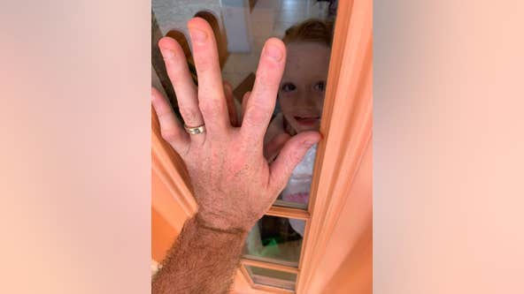 Viral photo shows nurse separated from family due to coronavirus concerns