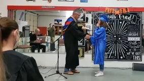 Phoenix teacher fulfills graduation promise to student who lost both parents