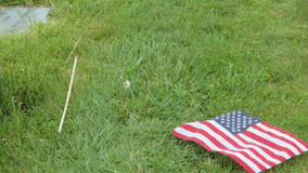 Police investigate after over 100 flags torn from veterans' graves