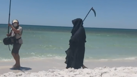'Grim Reaper' visits Florida beaches to protest reopening during pandemic