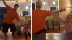 Dad shows off his best ballet moves while dancing with daughter