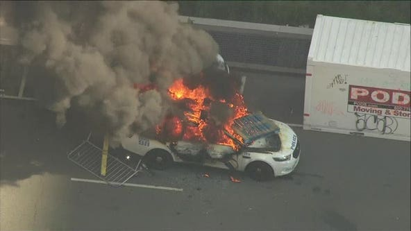 Protestors clash with police, set vehicles on fire in Center City