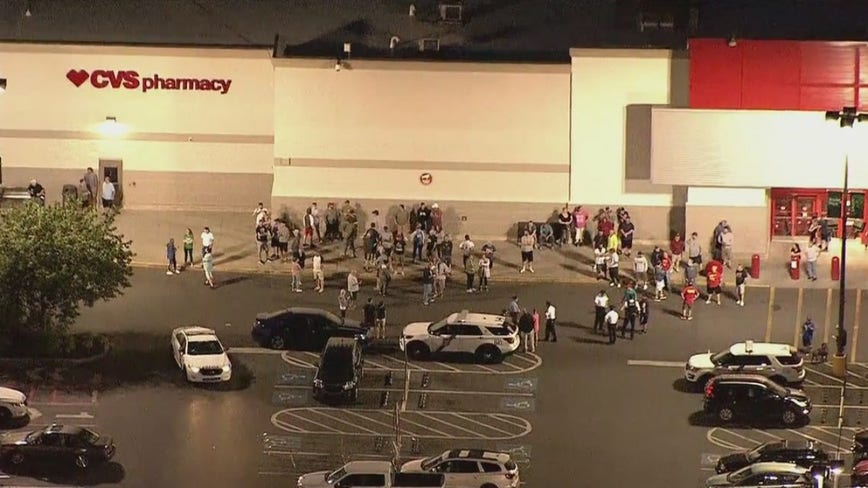 Dozens stand guard outside of South Philadelphia Target to protect from looters