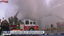 Firefighters continue to battle 2-alarm fire in Olney