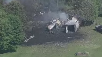 Coroner: 1 dead after blasts destroy building, damages tractor-trailer