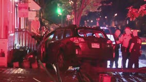 Police searching for driver after car jumps curb, burst into flames in Society Hill
