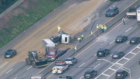 Overturned dump truck scatters sand, closes eastbound lanes of PA Turnpike near Fort Washington