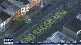 Hundreds paint 'End Racism Now' on Fishtown street