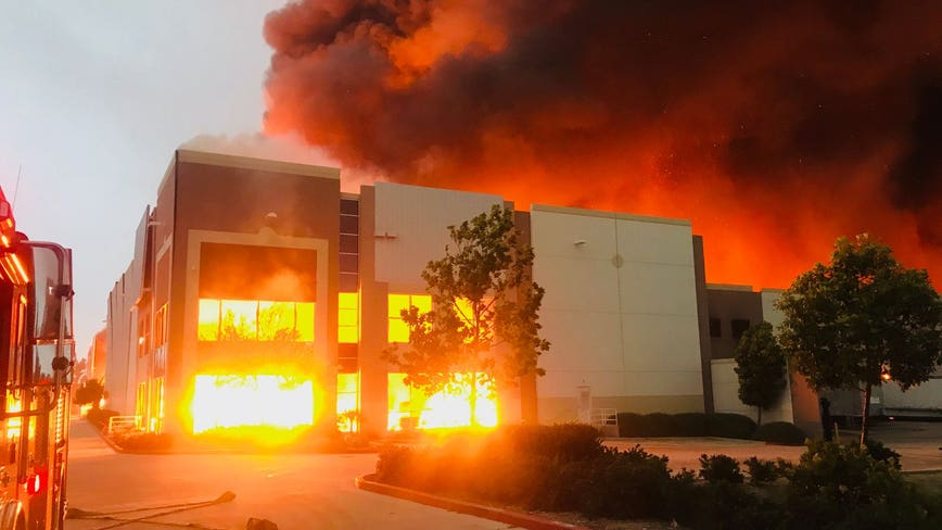 Massive fire ignites at Amazon distribution warehouse in Redlands