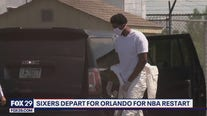 Sixers' Embiid wears coverall suit as team heads to Orlando for continuation of NBA season