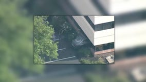 Driver escapes injuries after car crashes into office, officials say