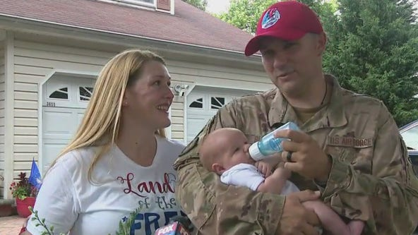 Air Force technical sergeant returns home from deployment, meets baby for first time