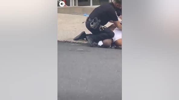 DA to investigate video showing Allentown police officer kneeling on man