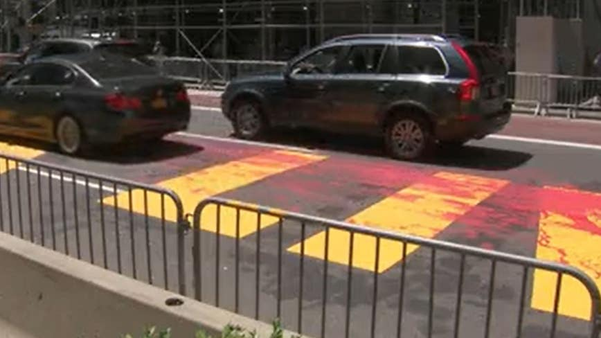Red paint splattered over Black Lives Matter mural outside Trump Tower