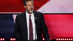 Liberty University official says Jerry Falwell Jr. resigning, but Falwell says he's not