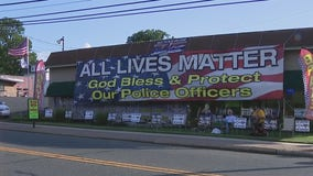"Group gathers to protest after Oaklyn business owner puts up ""All Lives Matter"" banner"