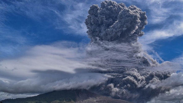 Sinabung volcano ejects towering column of ash over Indonesia