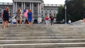 Firefighters and politicians climb Pennsylvania State Capitol steps to honor 9/11 first responders