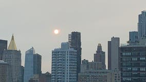 Smoke from West Coast wildfires creates haze during Monday night's sunset on East Coast