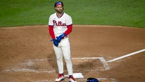 Phillies fail to sweep Blue Jays; Harper has stiff back