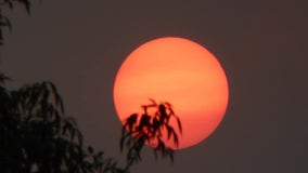 An eerie phenomenon: Wildfires cause sun, moon to glow red in Arizona
