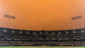Smoke from wildfires creates eerie baseball scene in California