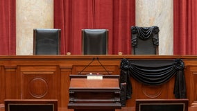 Supreme Court drapes black cloth over Justice Ruth Bader Ginsburg's seat, photos show