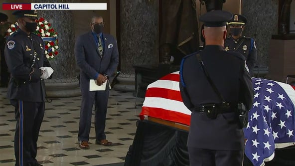 Ruth Bader Ginsburg's personal trainer does push-ups in front of her casket in tribute