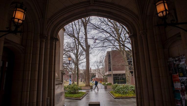 A man walks on campus at Princeton University.