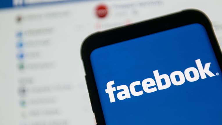 572b174f-In this photo illustration a Facebook logo seen displayed on