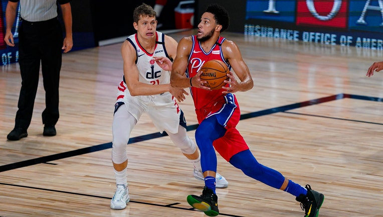 Ben Simmons drives to the basket against the Washington Wizards.