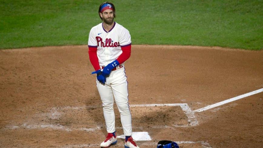 Phillies fail to sweep Blue Jays; Harper has stiff back