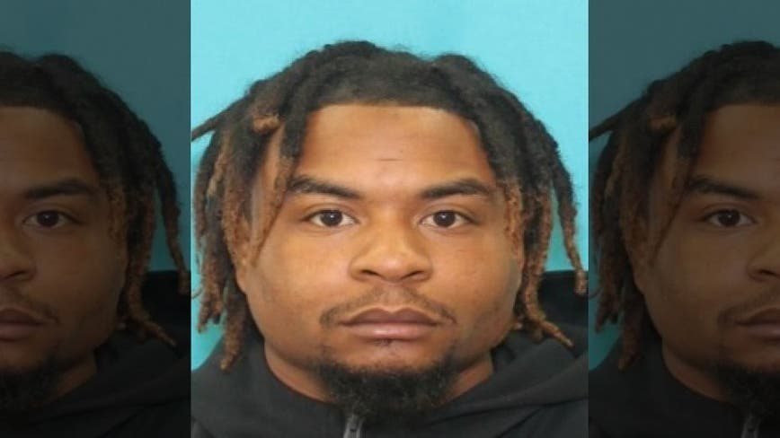 Man accused of opening fire on plainclothes police officers turns himself in