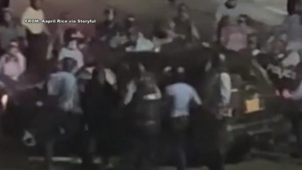 Lawyer: Mom, child trapped in crowd when police smashed car