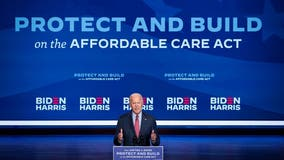 Biden fights to confront crises, Trump resistance