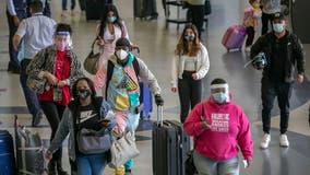 Holiday air travel surges despite dire health warnings