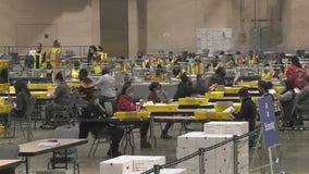 Election officials urge patience as workers sort through mountain of mail-in ballots